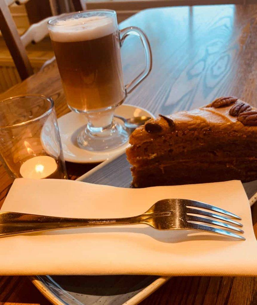 Irish coffee with a cake on the side